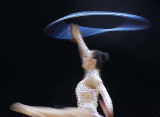 Russia&#39;s Daria Dmitrieva performs during the rhythmic gymnastics individual all-around qualifications at at the 2012 Summer Olympics, Thursday, Aug. 9, 2012, in London. &#40;AP Photo&#47;Julie Jacobson&#41; <span class=meta>(AP Photo&#47; Julie Jacobson)</span>