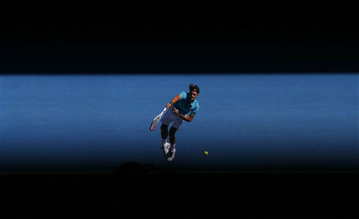 Switzerland&#39;s Roger Federer serves to France&#39;s Benoit Paire during their first round match at the Australian Open tennis championship in Melbourne, Australia, Tuesday, Jan. 15, 2013. &#40;AP Photo&#47;Andy Wong&#41; <span class=meta>(AP Photo&#47; Andy Wong)</span>