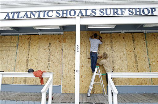 "<div class=""meta ""><span class=""caption-text "">Surf store workers Fletcher Birch, left, and Jay Kleman board up the windows of the store in Ocean City, Md. on Saturday, Oct. 27, 2012 as Hurricane Sandy approaches the Atlantic coast. (AP Photo/Jose Luis Magana) (AP Photo/ Jose Luis Magana)</span></div>"