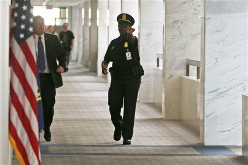 A Capitol police officer tells people to clear the hallway on the third floor of the Hart Senate Office building after reports of suspicious packages discovered on Capitol Hill in Washington, Wednesday, April 17, 2013. &#40;AP Photo&#47;Charles Dharapak&#41; <span class=meta>(AP Photo&#47; Charles Dharapak)</span>