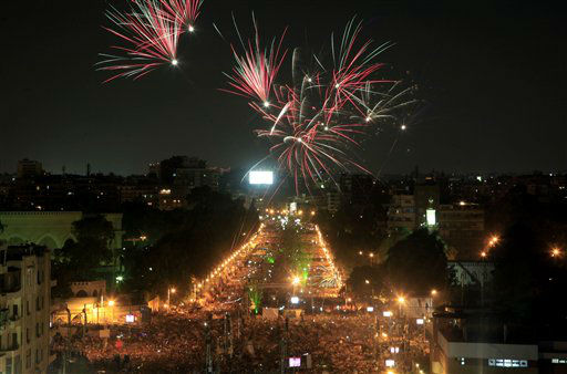 Fireworks light the sky as opponents of Egypt&#39;s Islamist President Mohammed Morsi protest outside the presidential palace in Cairo, Egypt, Monday, July 1, 2013. Egypt&#39;s powerful military warned on Monday it will intervene if the Islamist president doesn&#39;t &#34;meet the people&#39;s demands,&#34; giving him and his opponents two days to reach an agreement in what it called a last chance. Hundreds of thousands of protesters massed for a second day calling on Mohammed Morsi to step down. &#40;AP Photo&#47;Khalil Hamra&#41; <span class=meta>(AP Photo&#47; Khalil Hamra)</span>
