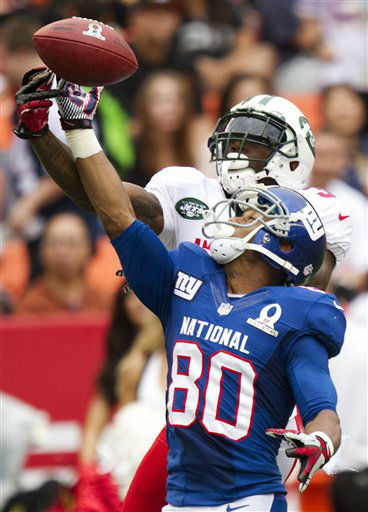 New York Jets cornerback Antonio Cromartie, top, of the AFC breaks up a pass intended for New York Giants wide receiver Victor Cruz &#40;80&#41; of the NFC in the fourth quarter of the NFL football Pro Bowl game in Honolulu, Sunday, Jan. 27, 2013. The NFC won 62-35. &#40;AP Photo&#47;Eugene Tanner&#41; <span class=meta>(AP Photo&#47; Eugene Tanner)</span>