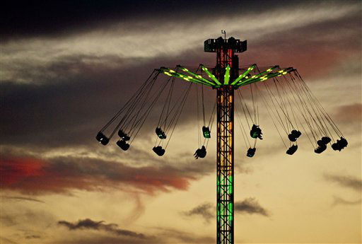 A carousel rotates during the Oktoberfest, the German Beer Festival at the Cathedral Square, in Erfurt, central Germany, Thursday, Sept. 27, 2012. The Oktoberfest event in Erfurt started on Sept. 22 and last until Oct. 7, 2012. &#40;AP Photo&#47;Jens Meyer&#41; <span class=meta>(AP Photo&#47; Jens Meyer)</span>