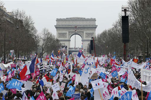 "<div class=""meta ""><span class=""caption-text "">Anti gay marriage and gay adoption protestors demonstrate, in Paris, Sunday, March. 24, 2013. Thousands of French conservatives, families and activists have converged on the capital to try to stop the country from allowing same-sex couples to marry and adopt children. The lower house of France's parliament approved the ""marriage for everyone"" bill last month with a large majority, and it's facing a vote in the Senate next month. Both houses are dominated by French President Francois Hollande's Socialist Party and its allies. (AP Photo/Thibault Camus) (AP Photo/ Thibault Camus)</span></div>"