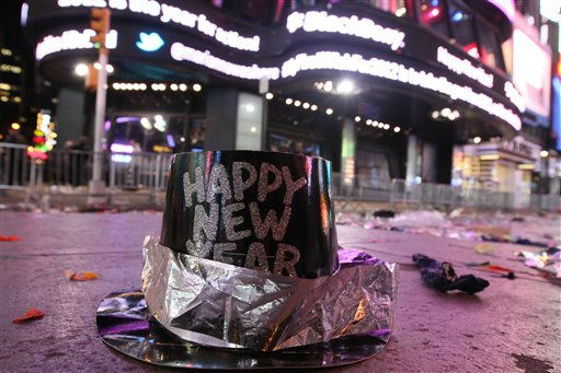 A New Year&#39;s hat is seen among other debris in Times Square after 2012 New Year&#39;s Eve celebrations in New York, Sunday, Jan. 1, 2012. &#40;AP Photo&#47;Tina Fineberg&#41; <span class=meta>(AP Photo&#47; Tina Fineberg)</span>