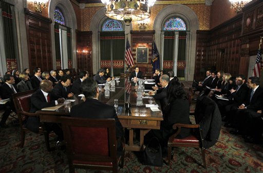"<div class=""meta ""><span class=""caption-text "">New York Gov. Andrew Cuomo, seated at the far end of the table, speaks during a cabinet meeting in the Red Room at the Capitol in Albany, N.Y., Saturday, Jan. 1, 2011.   (AP Photo/Mike Groll, Pool) (AP Photo/ Mike Groll)</span></div>"