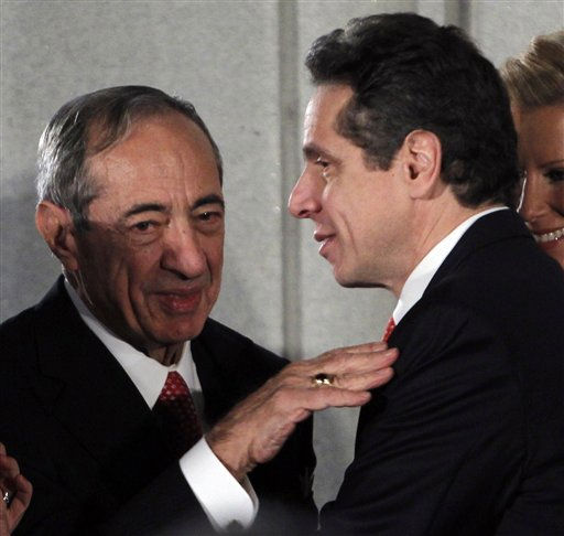 New York Gov. Andrew Cuomo, right, talks with his father and former New York Gov. Mario Cuomo, during a swearing-in ceremony in the War Room at the Capitol in Albany, N.Y., Saturday, Jan. 1, 2011.   &#40;AP Photo&#47;Mike Groll, Pool&#41; <span class=meta>(AP Photo&#47; Mike Groll)</span>