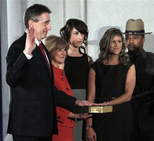 New York Lt. Gov. Robert Duffy, left, is sworn in during a ceremony at the Capitol in Albany, N.Y., Saturday, Jan. 1, 2011. Duffy&#39;s wife Barbara, left, and daughters Shannon and Erin are also pictured.  &#40;AP Photo&#47;Mike Groll, Pool&#41; <span class=meta>(AP Photo&#47; Mike Groll)</span>