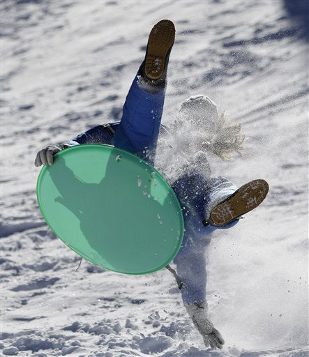 Nikki Tripputi takes flight  snow sledding in Angel Fire, New Mexico, Sunday, Jan. 2, 2011. Temperatures in the area have been unseasonably cold dipping below zero daily. &#40;AP Photo&#47;Eric Gay&#41; <span class=meta>(AP Photo&#47; Eric Gay)</span>