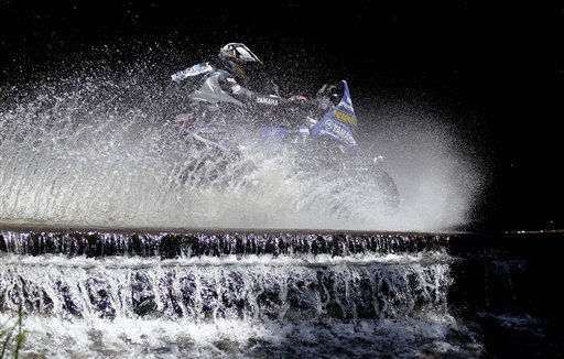 "<div class=""meta ""><span class=""caption-text "">Argentina's Alejandro Patronelli, rides his Yamaha quad during the first stage of the 2011 Argentina-Chile Dakar Rally between Victoria and Cordoba, Argentina, Sunday, Jan. 2, 2011. (AP Photo/Natacha Pisarenko) (AP Photo/ Natacha Pisarenko)</span></div>"
