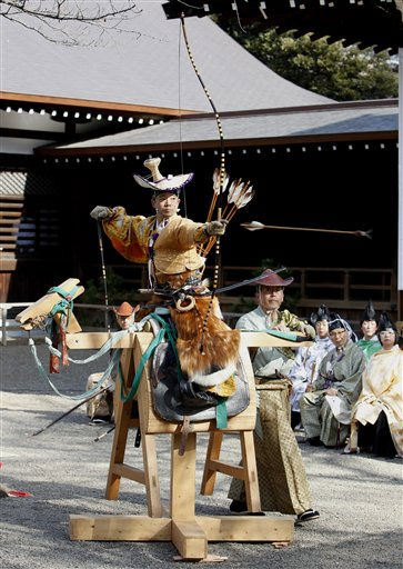 An archer dressed in a traditional Japanese warrior&#39;s attire shoots an arrow during New Year&#39;s Shito ritual ceremony of archery at Yasukuni Shrine in Tokyo Monday, Jan. 3, 2011. &#40;AP Photo&#47;Shizuo Kambayashi&#41; <span class=meta>(AP Photo&#47; Shizuo Kambayashi)</span>