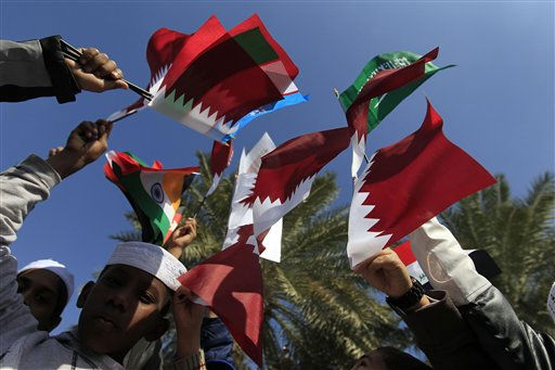 Qatari school children wave their national flag and pendants of the Asian Cup soccer tournament teams in Doha, Qatar, Monday, Jan. 3, 2011. The soccer tournament is to be kicked off on Jan. 7, with Iraq defending the title. &#40;AP Photo&#47;Hassan Ammar&#41; <span class=meta>(AP Photo&#47; Hassan Ammar)</span>