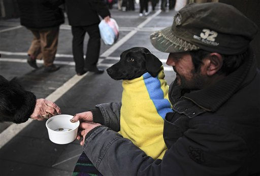 Luis, 48, an unemployed construction crane operator since 2009,  begs for alms accompanied by his dog, Luna, on the Estafeta street  in Pamplona northern Spain, Tuesday Jan.4, 2011. More than 60 percent of the Spanish are concerned about the economic crisis, according by the latest Spanish economic official survey known today.  Spain has suffered a long economic crisis with more than four million unemployed. &#40;AP Photo&#47;Alvaro Barrientos&#41; <span class=meta>(AP Photo&#47; Alvaro Barrientos)</span>