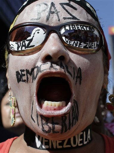 "<div class=""meta image-caption""><div class=""origin-logo origin-image ""><span></span></div><span class=""caption-text"">An opponent of Venezuela?s President Hugo Chavez, with the words 'Freedom', 'Democracy' and 'Peace' written on his face, shout slogans during a rally near the National Assembly in Caracas, Venezuela, Wednesday, Jan. 5, 2011. Opposition lawmakers gained a bigger presence and a platform to challenge Chavez, though the congress' powers will be limited by a recent measure letting the president enact laws by decree. Venezuela's new Congress had its first session Wednesday. (AP Photo/Ariana Cubillos) (AP Photo/ Ariana Cubillos)</span></div>"