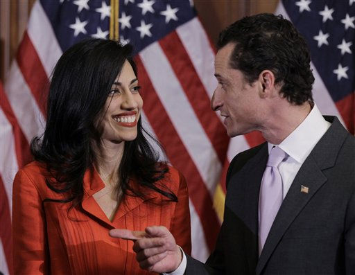 Rep. Anthony Weiner, D-N.Y., and his wife, Huma Abedin, aide to Secretary of State Hillary Rodham Clinton, are pictured after a ceremonial swearing in of the 112th Congress on Capitol Hill in Washington, Wednesday, Jan. 5, 2011. &#40;AP Photo&#47;Charles Dharapak&#41; <span class=meta>(AP Photo&#47; Charles Dharapak)</span>