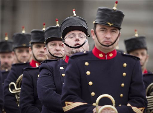 A member of the Spanish Royal Guard, second right, snoozes as he waits for the start of the Pascua Militar annual Christmas military parade at the Royal Palace in Madrid on Thursday, Jan. 6, 2011.&#40;AP Photo&#47;Victor R. Caivano&#41; <span class=meta>(AP Photo&#47; Victor R. Caivano)</span>