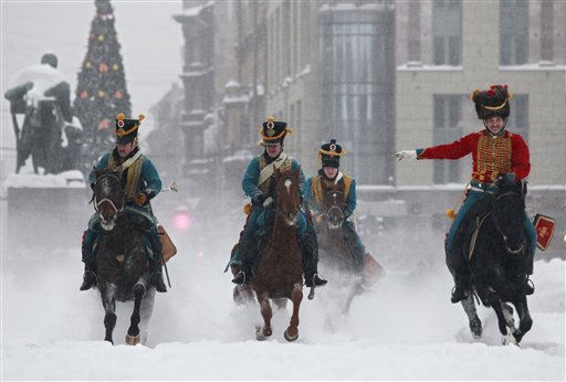 Riders dressed as soldiers of the Russian army in the times of the Russian- France 1812 war perform during Russia Orthodox Christmas celebrations in downtown St.Petersburg, Russia, Friday, Jan. 7, 2011. Christmas falls on Jan. 7 for Orthodox Christians that use the old Julian calendar instead of the 16th-century Gregorian calendar adopted by Catholics and Protestants and commonly used in secular life around the world. &#40;AP Photo&#47;Dmitry Lovetsky&#41; <span class=meta>(AP Photo&#47; Dmitry Lovetsky)</span>