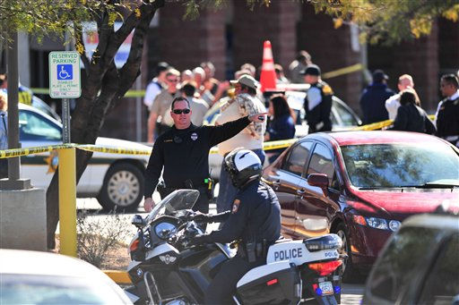"<div class=""meta ""><span class=""caption-text "">Emergency workers gather at the scene of a shooting involving Rep. Gabrielle Giffords, D-Ariz., Saturday, Jan. 8, 2011, at a Safeway grocery store in Tucson, Ariz.  (AP Photo/Chris Morrison) (AP Photo/ Chris Morrison)</span></div>"