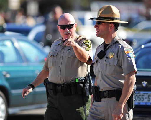 A sheriff gestures to an other officer at the scene at a shooting involving Rep. Gabrielle Giffords, D-Ariz., Saturday, Jan. 8, 2011, at a Safeway grocery store in Tucson, Ariz.  &#40;AP Photo&#47;Chris Morrison&#41; <span class=meta>(AP Photo&#47; Chris Morrison)</span>