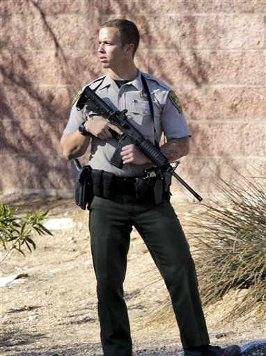 A Pima County Sheriff deputy stands guard at a rear entrance to a grocery store at the scene where Rep. Gabrielle Giffords, D-Ariz., and others were shot in Tucson, Ariz. on Saturday, Jan. 8, 2011. &#40;AP Photo&#47;Matt York&#41; <span class=meta>(AP Photo&#47; Matt York)</span>