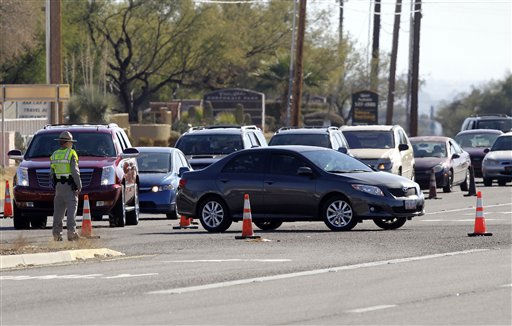 "<div class=""meta ""><span class=""caption-text "">Emergency personnel re-route traffic around the scene of a shooting involving Rep. Gabrielle Giffords, D-Ariz., outside a grocery store Saturday, Jan. 8, 2011 in Tucson, Ariz. (AP Photo/Matt York) (AP Photo/ Matt York)</span></div>"