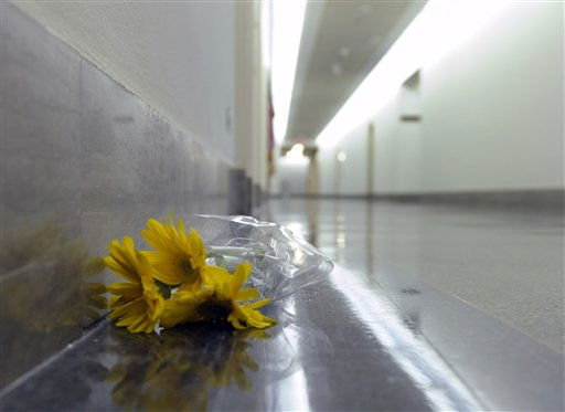 A lone bunch of flowers lays on the floor near the Capitol Hill office of Rep. Gabrielle Giffords, D-Ariz., Saturday, Jan. 8, 2011, on Capitol Hill in Washington. Giffords was shot in the head Saturday in her district in Arizona. &#40;AP Photo&#47;Susan Walsh&#41; <span class=meta>(AP Photo&#47; Susan Walsh)</span>