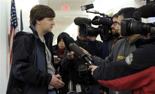 "<div class=""meta ""><span class=""caption-text "">Sean O'Brien, Chief of Staff for Rep. Mike Quigley, D-Ill., speaks to reporters after stopping by the Capitol Hill office of Rep. Gabrielle Giffords, D-Ariz., Saturday, Jan. 8, 2011 on Capitol Hill in Washington. Giffords is in critical condition after being shot in the head in her district in Arizona Saturday, Jan. 8, 2011. (AP Photo/Susan Walsh) (AP Photo/ Susan Walsh)</span></div>"