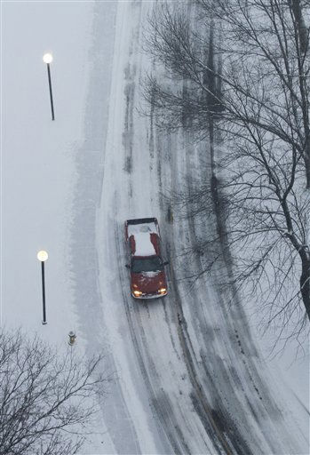 A vehicle drives along a snow and ice-packed road in Lenexa, Kan., on Monday, Jan. 10, 2011. A winter storm hit the area making travel difficult and causing the local schools to cancel classes for the day. &#40;AP Photo&#47;Jeff Tuttle&#41; <span class=meta>(AP Photo&#47; Jeff Tuttle)</span>