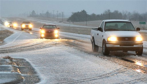 Drivers slowly make their way down Highway 45, outside of Artesia, Miss after winter weather covered the area in snow and ice, Monday, Jan. 10, 2011. &#40;AP Photo&#47; Kerry Smith&#41; <span class=meta>(AP Photo&#47; Kerry Smith)</span>