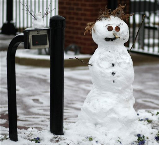 Residents of 21 Apartments in Starkville, Miss built two snowmen from the snow that fell Sunday nights&#39; winter weather, to greet visitors at the main gate, Monday, Jan. 10, 2011. &#40;AP Photo&#47; Kerry Smith&#41; <span class=meta>(AP Photo&#47; Kerry Smith)</span>