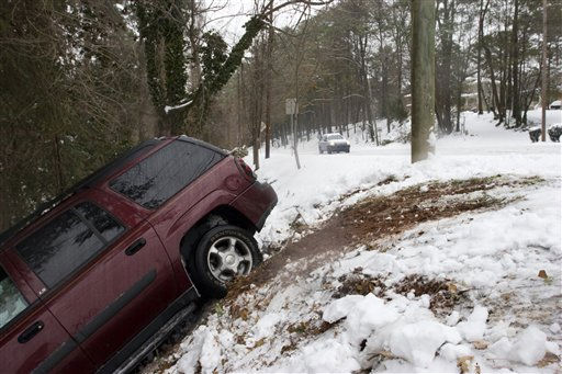 A wrecked sport utility vehicle is seen wrecked down a roadside embankment in Decatur, Ga. on Monday, Jan. 10, 2011. Icy road conditions made driving treacherous throught the greater metro Atlanta region. &#40;AP Photo&#47; Ron Harris&#41; <span class=meta>(AP Photo&#47; Ron Harris)</span>