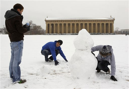 This Jan. 10, 2011 photo shows Ben Dodson, left, Lucas Wheeler, center, and Garry Nelson, right, making a snowman in front of the Parthenon in Nashville, Tenn. The Parthenon, a full-scale replica of the original Greek structure, is one of Nashville&#39;s tourist attractions. Tennessee tourism has coped with persistent snow and bone-chilling cold weather in January. &#40;AP Photo&#47;Mark Humphrey&#41; <span class=meta>(AP Photo&#47; Mark Humphrey)</span>