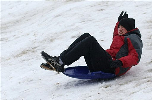 Ben Hester, a student a Mississippi State, holds on to the sled as he slides down the icy hill from the winter weather, Monday, Jan. 10, 2011.  <span class=meta>(&#40;AP Photo&#47; Kerry Smith&#41;)</span>