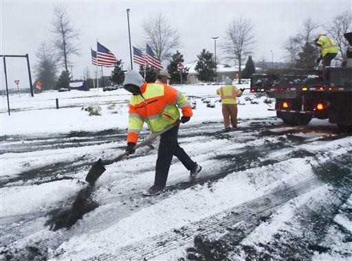 City contractors including Antoine Calloway, left, spreads sand on roadways after an overnight winter storm that has deposited several inches of snow Monday, Jan. 10, 2011, in Johns Creek, Ga. &#40;AP Photo&#47;John Amis&#41; <span class=meta>(AP Photo&#47; John Amis)</span>