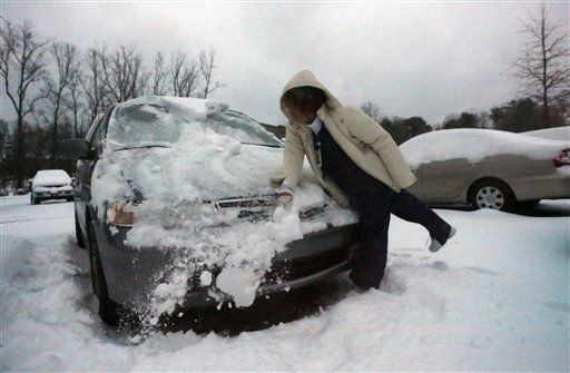 Rena Rabad, a nurse at Emory Johns Creek hospital clears snow from her car after an overnight winter storm that has deposited several inches of snow and sleet Monday, Jan. 10, 2011, in Johns Creek, Ga. &#40;AP Photo&#47;John Amis&#41; <span class=meta>(AP Photo&#47; John Amis)</span>