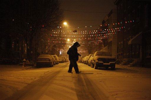 A person makes their way through a snow storm, Tuesday, Jan. 11, 2011, in Philadelphia. (AP Photo/Matt Slocum)