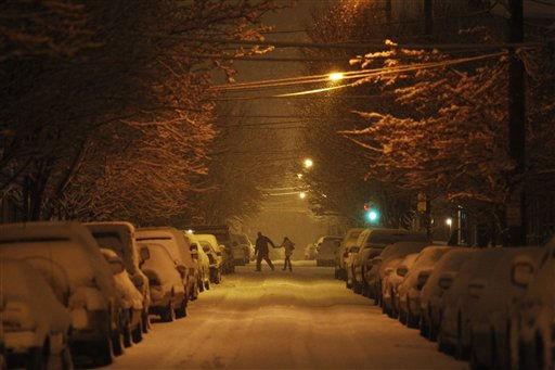 A couple make their way through a snow storm, Tuesday, Jan. 11, 2011, in Philadelphia. (AP Photo/Matt Slocum)