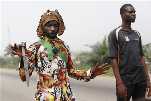 "<div class=""meta image-caption""><div class=""origin-logo origin-image ""><span></span></div><span class=""caption-text"">A rebel soldier gestures to show that his only weapon is a knife, as he describes how heavily-armed security forces descended on the neighborhood and killed at least two people, in the Abobo neighborhood of Abidjan, Ivory Coast, Tuesday, Jan. 11, 2011.  U.N. peacekeepers retreated from a neighborhood where security forces loyal to incumbent leader Laurent Gbagbo had opened fire Tuesday, turning around at least nine U.N. vehicles after dozens of angry young men built a blockade.(AP Photo/Rebecca Blackwell) (AP Photo/ Rebecca Blackwell)</span></div>"