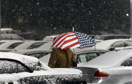 "<div class=""meta image-caption""><div class=""origin-logo origin-image ""><span></span></div><span class=""caption-text"">Salesman John Boorse Jr. carries an umbrella as he walks on a car lot in a snowfall Tuesday, Jan. 11, 2011, in Newtown, Pa. Snow is predicted to fall through Wednesday in the region. (AP Photo/Mel Evans)</span></div>"