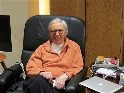 FILE - This January, 2011, file photo provided by Roger Ebert shows the famous film critic wearing a silicone prosthesis over his lower face and neck. Ebert died on Thursday, April 4, 2013 after a recurrence of cancer. He was 70. (AP Photo/Ebert Productions, David Rotter, file)