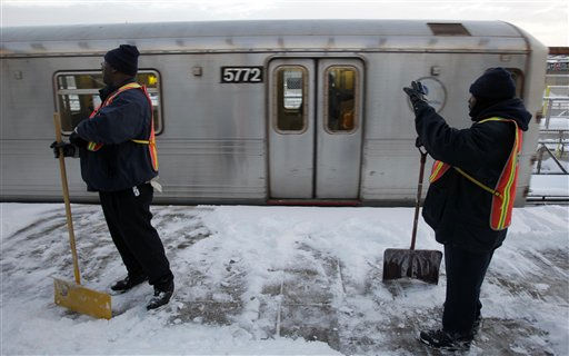 "<div class=""meta image-caption""><div class=""origin-logo origin-image ""><span></span></div><span class=""caption-text"">Transit workers pause from shoveling snow as a train pulls into the station in New York, Wednesday, Jan. 12, 2011. Armies of plows and salt spreaders hit the streets up and down the East Coast to stem chaos during Wednesday morning's commute as a storm that shut down much of the South churned northward and dumped several inches of wet, heavy snow on areas already weary of winter. (AP Photo/Seth Wenig) (AP Photo/ Seth Wenig)</span></div>"