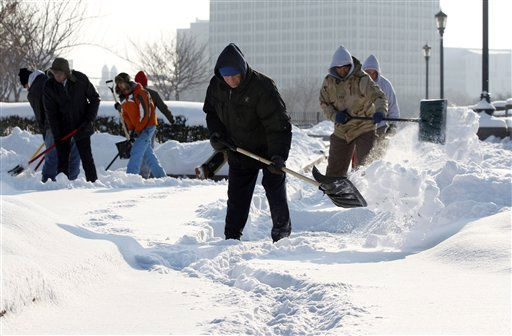"<div class=""meta image-caption""><div class=""origin-logo origin-image ""><span></span></div><span class=""caption-text"">A crew shovels snow from walkways Wednesday, Jan. 12, 2011, in Trenton, N.J. A winter storm that shut down much of the South churned up the coast Wednesday, dumping wet, heavy snow across the Northeast. (AP Photo/Mel Evans) (AP Photo/ Mel Evans)</span></div>"