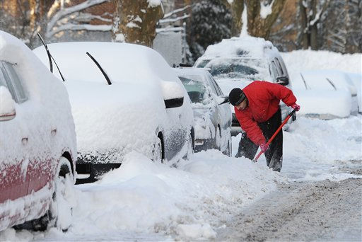 "<div class=""meta image-caption""><div class=""origin-logo origin-image ""><span></span></div><span class=""caption-text"">Joe Martinta digs out a third car this morning from a pile of snow on Charles Street in Mineola, N.Y. Snow covered areas throughout Long Island on Wednesday, Jan. 12, 2011, in New York. (AP Photo/Kathy Kmonicek) (AP Photo/ Kathy Kmonicek)</span></div>"
