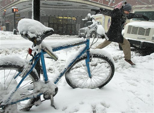"<div class=""meta image-caption""><div class=""origin-logo origin-image ""><span></span></div><span class=""caption-text"">A man leaps past a snow covered bicycle while crossing a street in the Downtown Crossing in Boston, Wednesday, Jan. 12, 2011. The Boston area is expected to receive well over a foot of snow during a day long winter storm.(AP Photo/Charles Krupa) (AP Photo/ Charles Krupa)</span></div>"