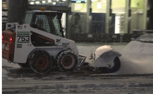 "<div class=""meta image-caption""><div class=""origin-logo origin-image ""><span></span></div><span class=""caption-text"">As snow continues to fall a snow sweeper clears the accumulation from in front of an all-night drug store in New York early Wednesday Jan. 12, 2011. The New York area is bracing itself for for it's second major snow fall since Christmas. (APPhoto/Rich Kareckas)</span></div>"