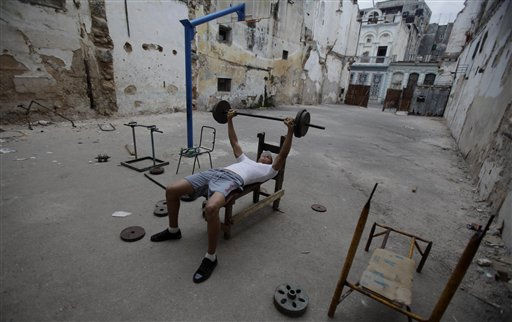 A teenager lifts weights in an improvised gym in Havana, Cuba, Thursday Jan.13, 2011.(AP Photo/Javier Galeano)