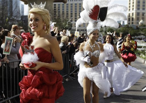 Miss Nebraska, Teresa Scanlan, left, followed by Miss Nevada Cris Crotz and Miss New Hampshire, Krystal Lee Muccioli walk in the &#34;Show Us Your Shoes&#34; parade as part of this week&#39;s Miss America festivities Friday, Jan. 14, 2011 in Las Vegas. &#40;AP Photo&#47;Julie Jacobson&#41; <span class=meta>(AP Photo&#47; Julie Jacobson)</span>