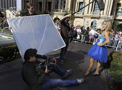 Miss America contestant, Katie Lynn LaRoche, Miss Michigan, stops to be filmed during the &#34;Show Us Your Shoes&#34; parade, Friday, Jan. 14, 2011 in Las Vegas.  &#40;AP Photo&#47;Julie Jacobson&#41; <span class=meta>(AP Photo&#47; Julie Jacobson)</span>