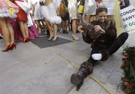 Miss America contestant, Arikka Knights, Miss Maine, changes her boots after the &#34;Show Us Your Shoes&#34; parade, Friday, Jan. 14, 2011 in Las Vegas. &#40;AP Photo&#47;Julie Jacobson&#41; <span class=meta>(AP Photo&#47; Julie Jacobson)</span>