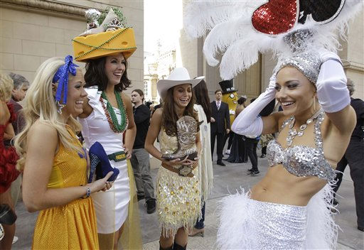 Miss America contestants, from left, Cali Young, Miss West Virginia, Kimberly Brooke Sawyer, Miss Wisconsin, Alicia Grove, Miss Wyoming, and Cris Crotz, Miss Nevada, talk together before the start of the &#34;Show Us Your Shoes&#34; parade  Friday, Jan. 14, 2011 in Las Vegas. &#40;AP Photo&#47;Julie Jacobson&#41; <span class=meta>(AP Photo&#47; Julie Jacobson)</span>